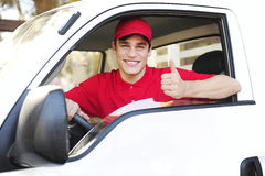 Postal delivery courier in a van Stock Photography