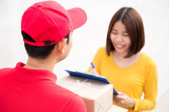 Postal delivery man delivering boxes to a woman Stock Photo