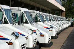 Postal delivery trucks. Some postal delivery trucks in line Stock Images