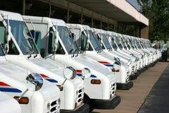 Postal delivery trucks. Some postal delivery trucks in line