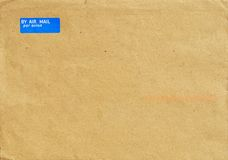 Postal envelope made of light brown recycled paper. The front of airmail envelope with By Air Mail stamp. May be used as background or texture Stock Images