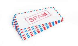 Postal letters with a spam. On a white background Royalty Free Stock Image