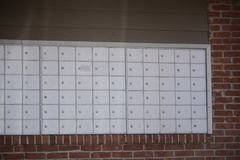 Postal Mail Mailboxes. Multiple secure and locked mailboxes in a central location at some apartments, condos or high-rise residential homes Stock Photo