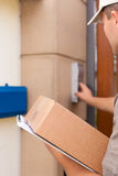 Postal service - delivery of a package Royalty Free Stock Photography
