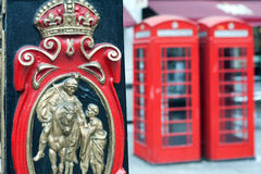 Postal Service and a red telephone booth in London Royalty Free Stock Images