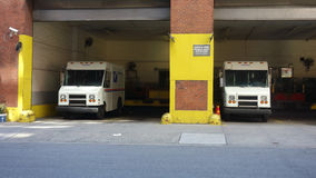 Postal Service Trucks. USPS trucks parked at a post office station in Manhattan Stock Photography