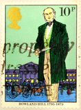 A postal stamp of Great Britain shows Rowland Hill royalty free stock images