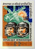 Postal stamp of Laos shows the Soviet cosmonauts Aleksei Gubarev and Georgi Grechko. royalty free stock photo