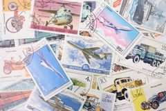 Postal stamps background. Many postal stamps joint by transport plot Stock Photos