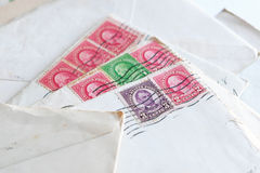 Postal stamps on old letters, envelopes Royalty Free Stock Image