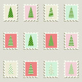 Postal stamps set fir-trees. Postal stamps set fir-trees on pastel color swatches Royalty Free Stock Photo