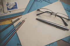 Postal stationery are on the table. Stock Image