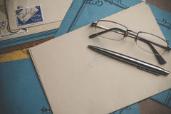 Postal stationery are on the table. Royalty Free Stock Photo