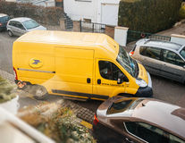 Postal van leaving after parcel delivery Stock Photo