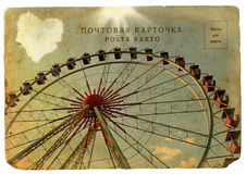 Postal vieja con una rueda de Ferris grande. Imagenes de archivo