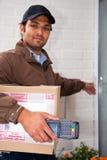 Postal worker at the door Stock Images