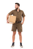 Postal worker with a package. Royalty Free Stock Images
