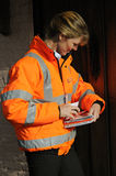 Postal worker sorting mail. Postal worker sorting letters on customers doorstep Royal Mail delivery postwoman Stock Photos