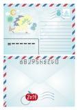 Postal y sellos de la Navidad del vintage Imágenes de archivo libres de regalías