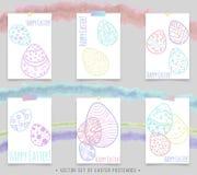 Postales de Pascua con los huevos coloreados Foto de archivo