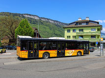 PostAuto bus in the town of Stans, Switzerland Stock Photos