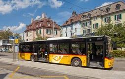 Postauto bus in Zurich. Zurich, Switzerland - 7 September, 2014: Postauto bus at the Wiedikon railway station (German: Bahnhof Wiedikon) stop. Zurich is the Stock Images