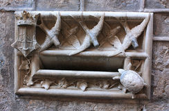Postbox. Letterbox with animal sculpture in a ancient building, Barcelona, Spain Stock Image