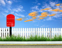 Postbox and brown envelope Royalty Free Stock Image