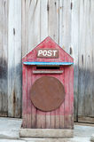 Postbox in front of wooden door Stock Photography