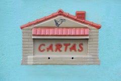 Postbox house on blue wall, Brazil Stock Photos