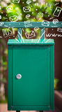 Postbox med vit hand drog postsymboler Royaltyfria Bilder
