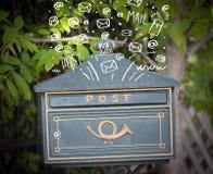Postbox med vit hand drog postsymboler Fotografering för Bildbyråer