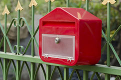 Postbox oblique angle. Cabinet oblique angle Gated waterfront home evening stock image