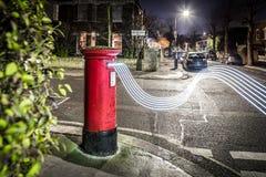 Postbox- och ljusslingor i London förort Fotografering för Bildbyråer