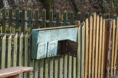 Postbox. Old iron postbox in village on fence Royalty Free Stock Photos