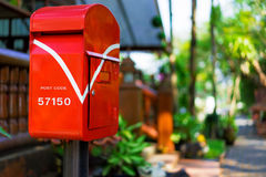 Postbox red in the garden. Royalty Free Stock Image