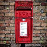 Postbox. Red wall postbox Stock Image