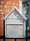 Postbox with white hand drawn mail icons Stock Photography