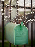 Postbox with white hand drawn mail icons Stock Photo