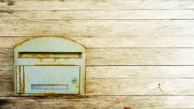 Postbox. On the wood background Royalty Free Stock Photos