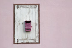 Postbox on wood window Stock Photos