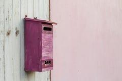 Postbox on wood window Royalty Free Stock Photo