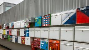 Postboxes multicolori in una fila fotografia stock libera da diritti