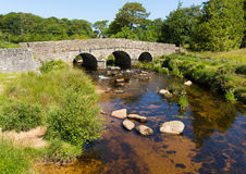 Postbridge clapper bridge Dartmoor National Park Devon England UK. Postbridge ancient clapper bridge at in Dartmoor National Park Devon England UK.   This small Royalty Free Stock Photo