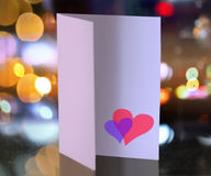 Postcard. For Valentine's day with hearts on luminous background Royalty Free Stock Images