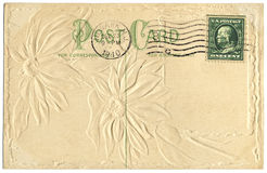 Postcard from 1910. An old postcard from 1910 with an embossed floral design on the back stock photo
