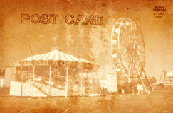 Postcard. Vintage Grunge Style Postcard Of Carnival Rides stock images