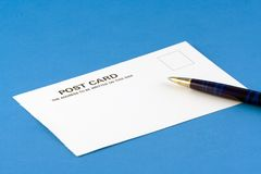 Postcard. A postcard and pen Royalty Free Stock Photo