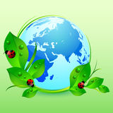 Postcard on April 22 - Earth day. Globe with green leaves and ladybugs on green. Vector illustration Royalty Free Stock Images