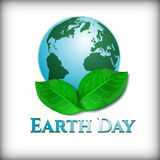 Postcard on April 22 - Earth day. Globe with green leaves. Vector illustration Royalty Free Stock Photography
